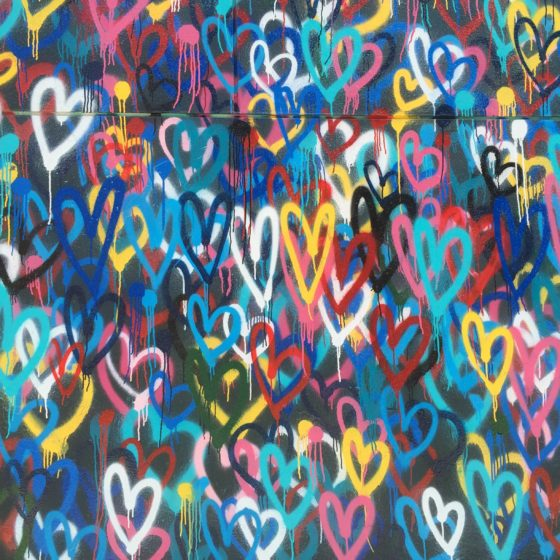graffiti of hearts on a wall representing love in the workplace